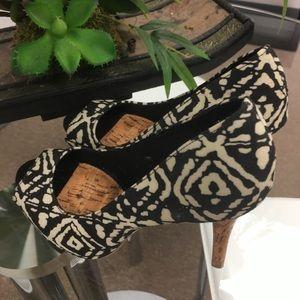 Christian Sirano tribal pattern platform heels.